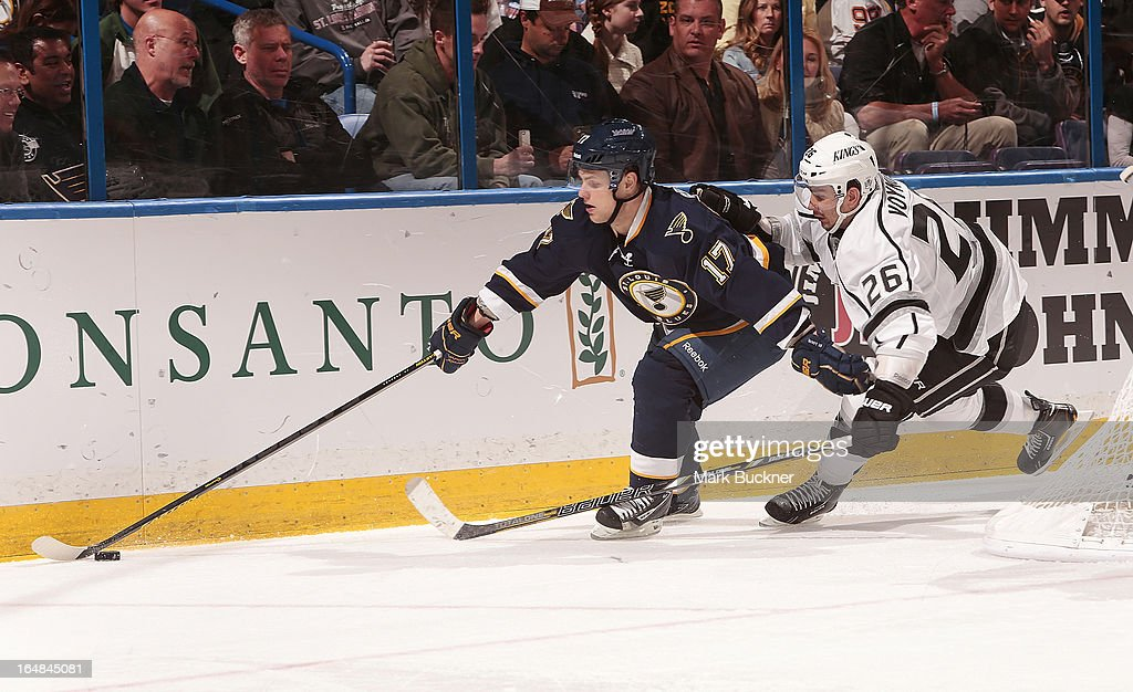 <a gi-track='captionPersonalityLinkClicked' href=/galleries/search?phrase=Vladimir+Sobotka&family=editorial&specificpeople=716736 ng-click='$event.stopPropagation()'>Vladimir Sobotka</a> #17 of the St. Louis Blues handles the puck as <a gi-track='captionPersonalityLinkClicked' href=/galleries/search?phrase=Slava+Voynov&family=editorial&specificpeople=8315719 ng-click='$event.stopPropagation()'>Slava Voynov</a> #26 of the Los Angeles Kings defends in an NHL game on March 28, 2013 at Scottrade Center in St. Louis, Missouri.