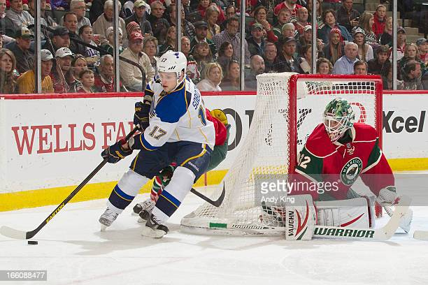 Vladimir Sobotka of the St Louis Blues handles the puck while goalie Niklas Backstrom of the Minnesota Wild defends during the game on April 1 2013...