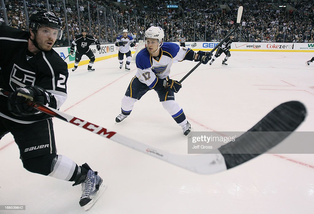 <a gi-track='captionPersonalityLinkClicked' href=/galleries/search?phrase=Vladimir+Sobotka&family=editorial&specificpeople=716736 ng-click='$event.stopPropagation()'>Vladimir Sobotka</a> #17 of the St. Louis Blues prepares to check <a gi-track='captionPersonalityLinkClicked' href=/galleries/search?phrase=Colin+Fraser&family=editorial&specificpeople=2225768 ng-click='$event.stopPropagation()'>Colin Fraser</a> #24 of the Los Angeles Kings in the third period of Game Six of the Western Conference Quarterfinals during the 2013 NHL Stanley Cup Playoffs at Staples Center on May 10, 2013 in Los Angeles, California. The Kings defeated the Blues 2-1.