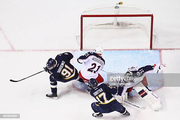 Vladimir Sobotka of the St Louis Blues scores a goal against Curtis McElhinney and James Wisniewski of the Columbus Blue Jackets at the Scottrade...