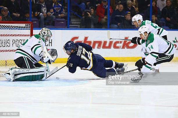 Vladimir Sobotka of the St Louis Blues scores a goal against Kari Lehtonen and Jamie Benn of the Dallas Stars at the Scottrade Center on November 23...