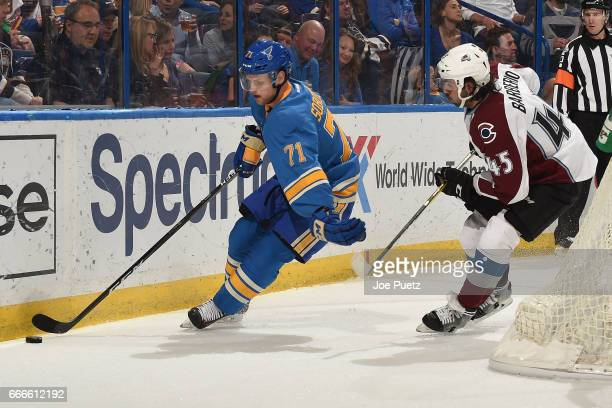 Vladimir Sobotka of the St Louis Blues skates with the puck as Mark Barberio of the Colorado Avalanche defends on April 9 2017 at Scottrade Center in...