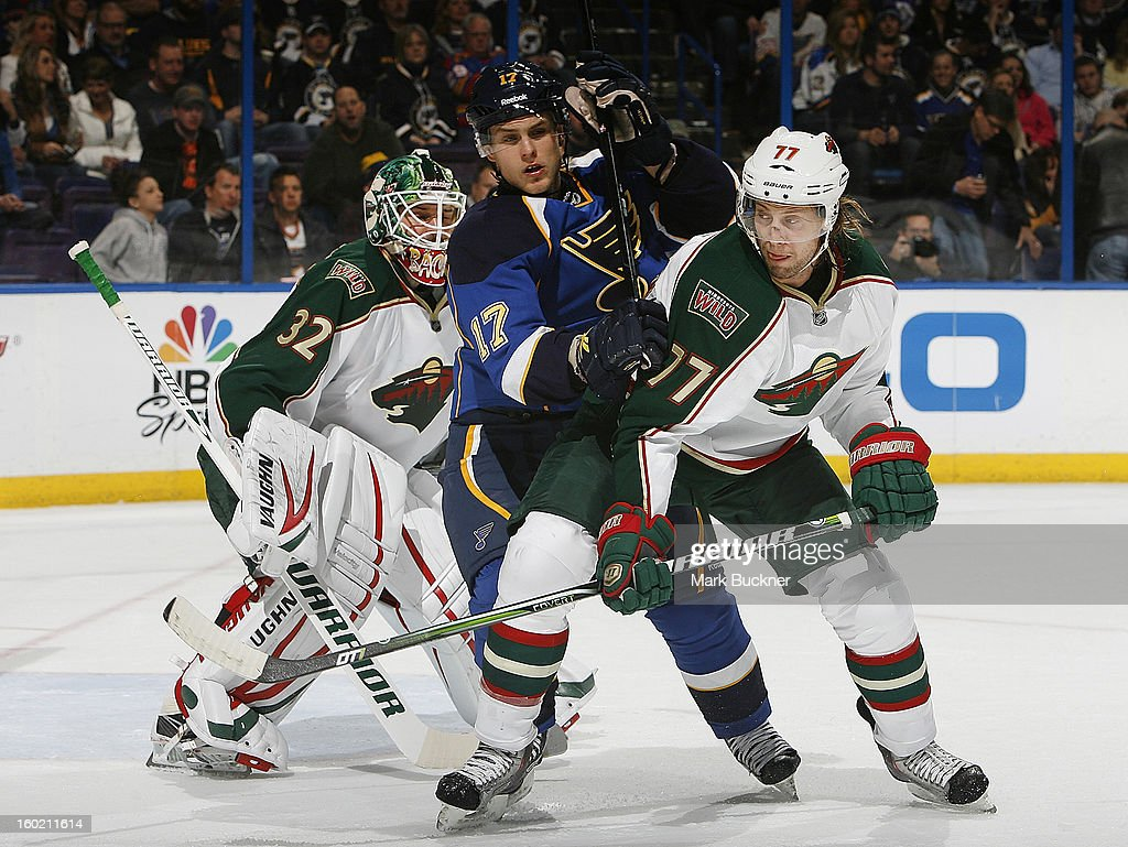 Vladimir Sobotka #17 of the St. Louis Blues splits the defense of Tom Gilbert #77 and Niklas Backstrom #32 of the Minnesota Wild in an NHL game on January 27, 2013 at Scottrade Center in St. Louis, Missouri.