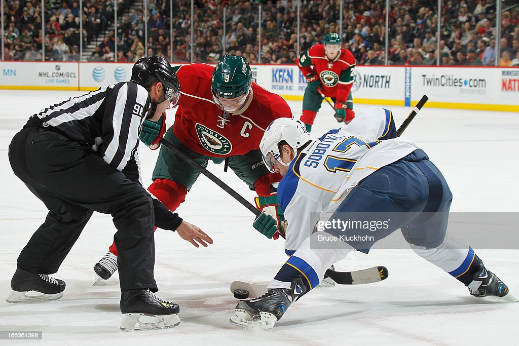<a gi-track='captionPersonalityLinkClicked' href=/galleries/search?phrase=Vladimir+Sobotka&family=editorial&specificpeople=716736 ng-click='$event.stopPropagation()'>Vladimir Sobotka</a> #17 of the St. Louis Blues takes a faceoff against <a gi-track='captionPersonalityLinkClicked' href=/galleries/search?phrase=Mikko+Koivu&family=editorial&specificpeople=584987 ng-click='$event.stopPropagation()'>Mikko Koivu</a> #9 of the Minnesota Wild during the game on April 11, 2013 at the Xcel Energy Center in Saint Paul, Minnesota.