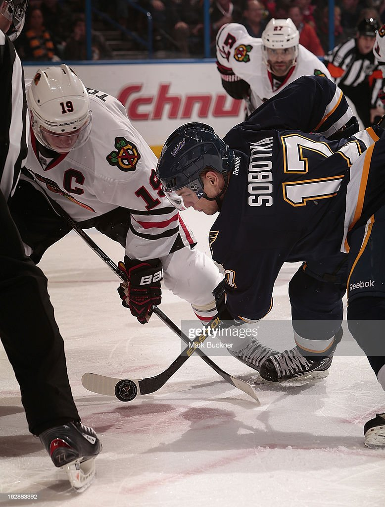 <a gi-track='captionPersonalityLinkClicked' href=/galleries/search?phrase=Vladimir+Sobotka&family=editorial&specificpeople=716736 ng-click='$event.stopPropagation()'>Vladimir Sobotka</a> #17 of the St. Louis Blues takes a face-off against <a gi-track='captionPersonalityLinkClicked' href=/galleries/search?phrase=Jonathan+Toews&family=editorial&specificpeople=537799 ng-click='$event.stopPropagation()'>Jonathan Toews</a> #19 of the Chicago Blackhawks in an NHL game on February 28, 2013 at Scottrade Center in St. Louis, Missouri.
