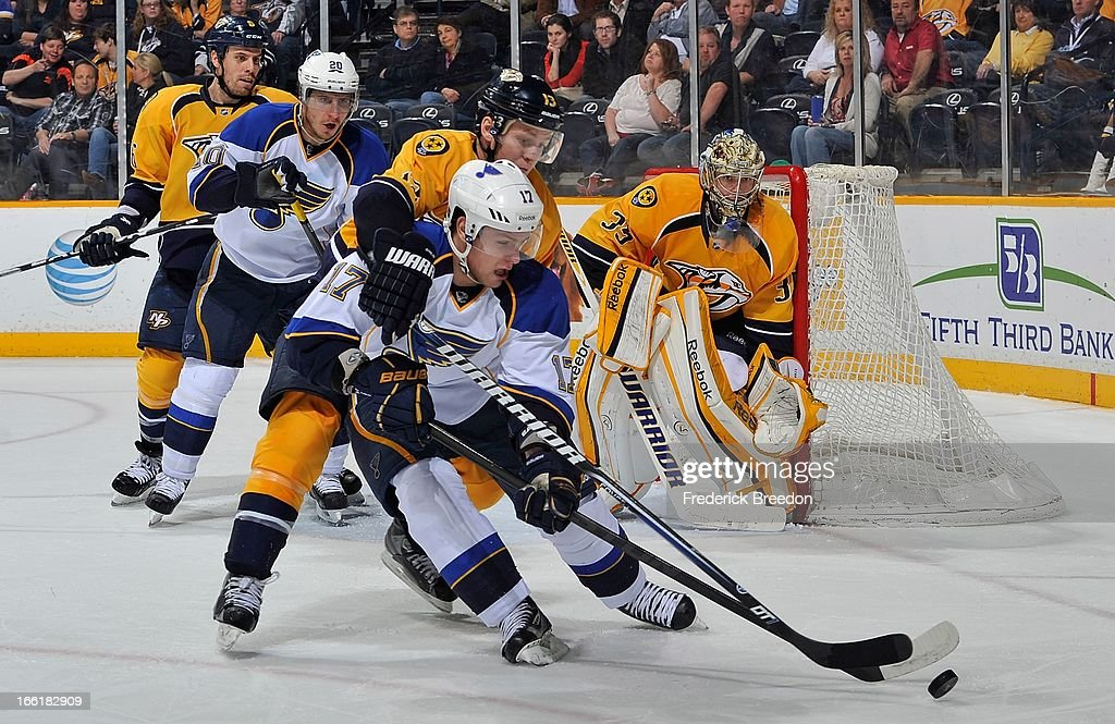 Vladimir Sobotka #17 of the St Louis Blues tries to handle the puck in front of goalie <a gi-track='captionPersonalityLinkClicked' href=/galleries/search?phrase=Pekka+Rinne&family=editorial&specificpeople=2118342 ng-click='$event.stopPropagation()'>Pekka Rinne</a> #35 of the Nashville Predators at the Bridgestone Arena on April 9, 2013 in Nashville, Tennessee.