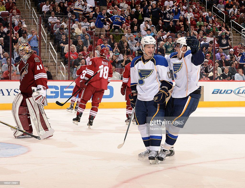 <a gi-track='captionPersonalityLinkClicked' href=/galleries/search?phrase=Vladimir+Sobotka&family=editorial&specificpeople=716736 ng-click='$event.stopPropagation()'>Vladimir Sobotka</a> #17 of the the St Louis Blues celebrates with teammate <a gi-track='captionPersonalityLinkClicked' href=/galleries/search?phrase=David+Perron&family=editorial&specificpeople=4282591 ng-click='$event.stopPropagation()'>David Perron</a> #57 after his third period goal against the Phoenix Coyotes at Jobing.com Arena on March 7, 2013 in Glendale, Arizona.
