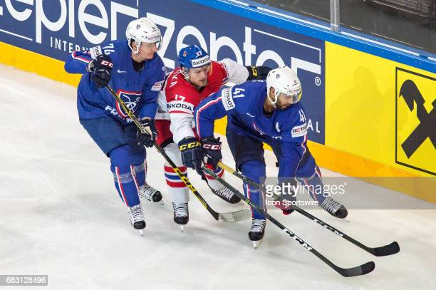 Vladimir Sobotka vies with Nicolas Besch and PierreEdouard Bellemare during the Ice Hockey World Championship between France and Czech Republic at...
