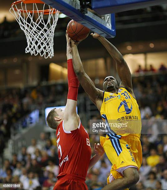Vladimir Stimac of FC Bayern Muenchen and Jamel McLean of ALBA Berlin during the game between Alba Berlin and FC Bayern Muenchen on November 9 2014...