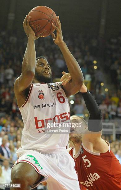 Vladimir Stimac of FC Bayern Muenchen fouls Darius Miller of the Brose Baskets Bamberg during Game Four of the 2015 BBL Finals at AudiDome on June 17...