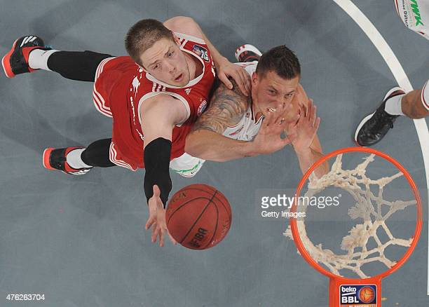 Vladimir Stimac of FC Bayern Muenchen shoots against Daniel Theis of Brose Baskets Bamberg during Game One of the 2015 BBL Finals at Brose Arena on...