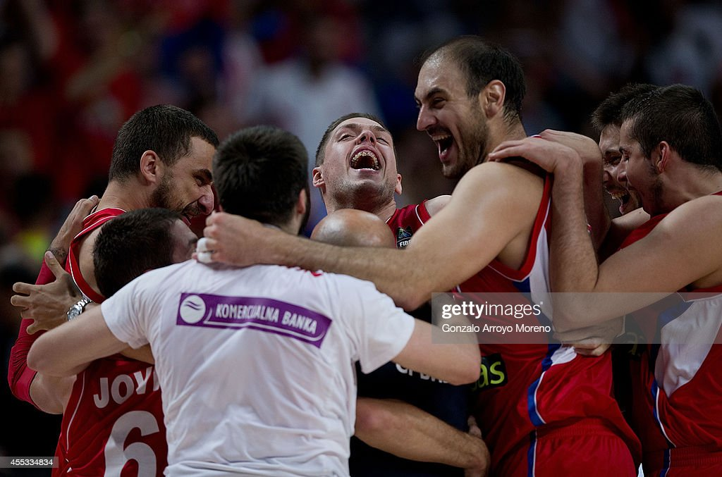 Vladimir Stimac of Serbia celebrates with teammates as Nenad Krstic their victory against France after the 2014 FIBA World Basketball Championship...