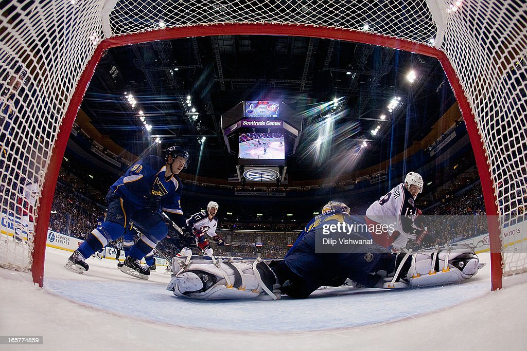 Vladimir Tarasenko and Jake Allen both of the St Louis Blues make a save against Cam Atkinson of the Columbus Blue Jackets at the Scottrade Center on...
