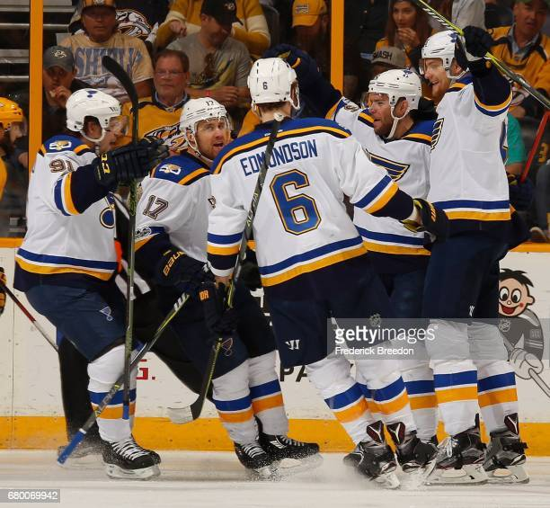 Vladimir Tarasenko Jaden Schwartzand Joel Edmundson of the St Louis Blues congratulate teammate Paul Stastny on scoring a goal against the Nashville...