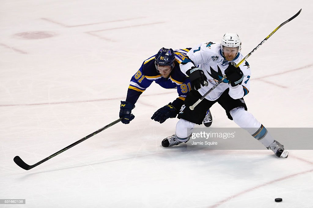 Vladimir Tarasenko #91 of the St. Louis Blues battles for the puck with Paul Martin #7 of the San Jose Sharks during the third period in Game One of the Western Conference Final during the 2016 NHL Stanley Cup Playoffs at Scottrade Center on May 15, 2016 in St Louis, Missouri.