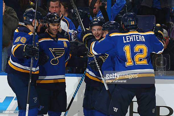 Vladimir Tarasenko of the St Louis Blues celebrates his goal against the New Jersey Devils with Ian Cole Barret Jackman also of the St Louis Blues at...