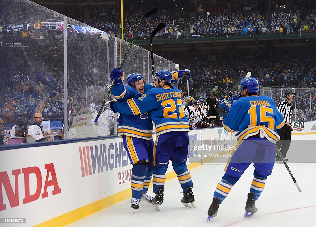 Vladimir Tarasenko #91 of the St. Louis Blues celebrates his goal against the Chicago Blackhawks with teammates Kevin Shattenkirk #22 and Robby Fabbri #15 during the 2017 Bridgestone NHL Winter Classic at Busch Stadium on January 2, 2017 in St Louis, Missouri.