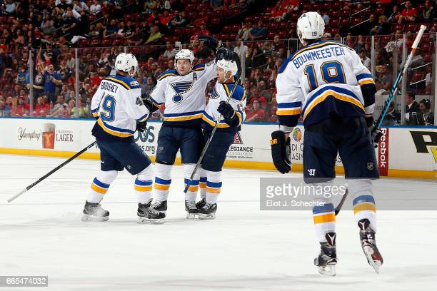 Vladimir Tarasenko of the St Louis Blues celebrates his goal with teammates Ivan Barbashev and Jaden Schwartz during the second period against the...