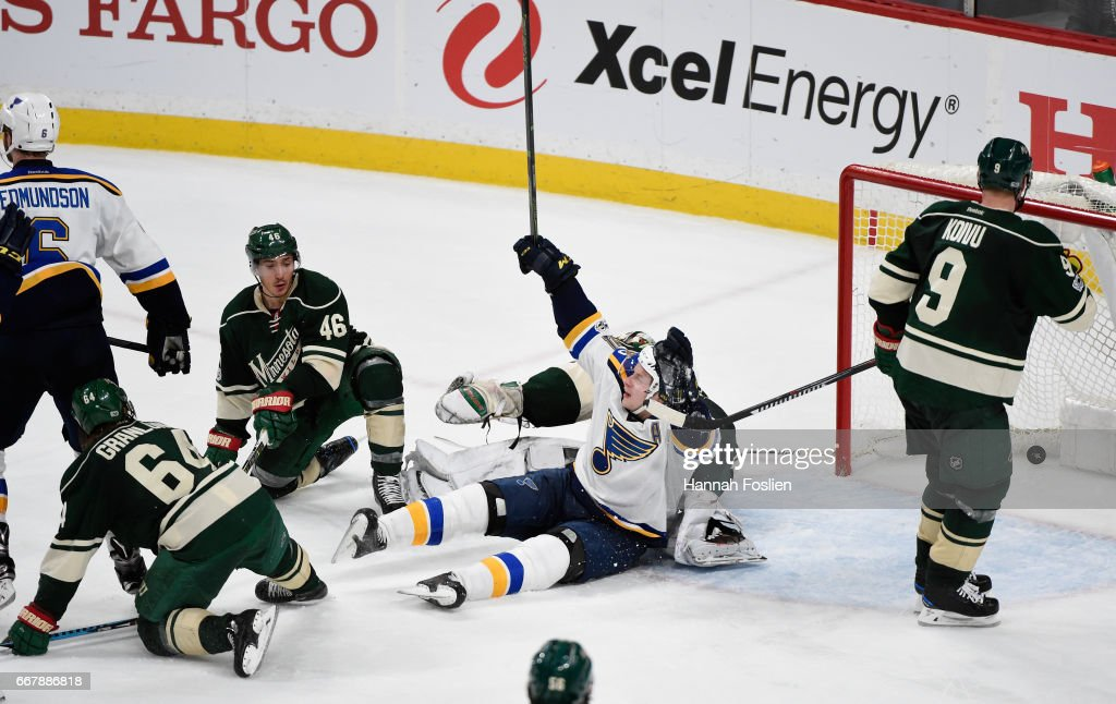 Vladimir Tarasenko #91 of the St. Louis Blues celebrates the game winning goal by teammate Joel Edmundson #6 as Mikael Granlund #64, Jared Spurgeon #46 and Mikko Koivu #9 of the Minnesota Wild look on after Game One of the Western Conference First Round during the 2017 NHL Stanley Cup Playoffs at Xcel Energy Center on April 12, 2017 in St Paul, Minnesota. The Blues defeated the Wild 2-1 in overtime.