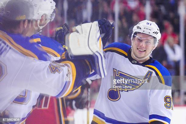 Vladimir Tarasenko of the St Louis Blues celebrates with teammates after scoring the team's fourth goal against the Calgary Flames during an NHL game...