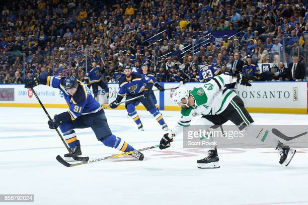 Vladimir Tarasenko of the St Louis Blues controls the puck as Alexander Radulov of the Dallas Stars pressures on October 7 2017 at Scottrade Center...