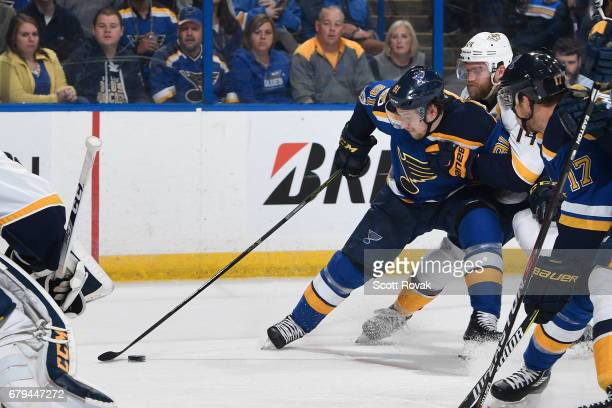 Vladimir Tarasenko of the St Louis Blues drives towards the net as Mattias Ekholm of the Nashville Predators defends in Game Five of the Western...