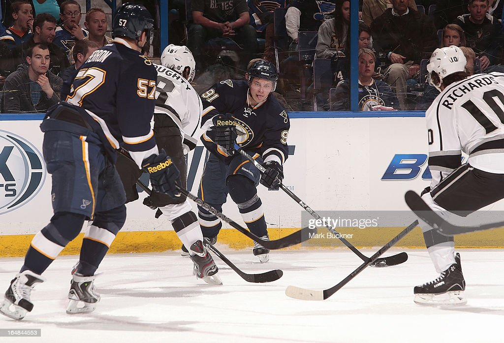 <a gi-track='captionPersonalityLinkClicked' href=/galleries/search?phrase=Vladimir+Tarasenko&family=editorial&specificpeople=6142635 ng-click='$event.stopPropagation()'>Vladimir Tarasenko</a> #91 of the St. Louis Blues handles the puck as <a gi-track='captionPersonalityLinkClicked' href=/galleries/search?phrase=Drew+Doughty&family=editorial&specificpeople=2085761 ng-click='$event.stopPropagation()'>Drew Doughty</a> #8 and Mike Richards #10 of the Los Angeles Kings defend in an NHL game on March 28, 2013 at Scottrade Center in St. Louis, Missouri.