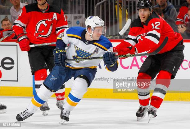 Vladimir Tarasenko of the St Louis Blues in action against Ben Lovejoy of the New Jersey Devils on November 7 2017 at Prudential Center in Newark New...