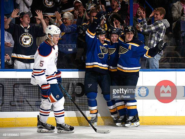 Vladimir Tarasenko of the St Louis Blues is congratulated on scoring a goal by Paul Stastny and Alexander Steen as Mark Fayne of the Edmonton Oilers...