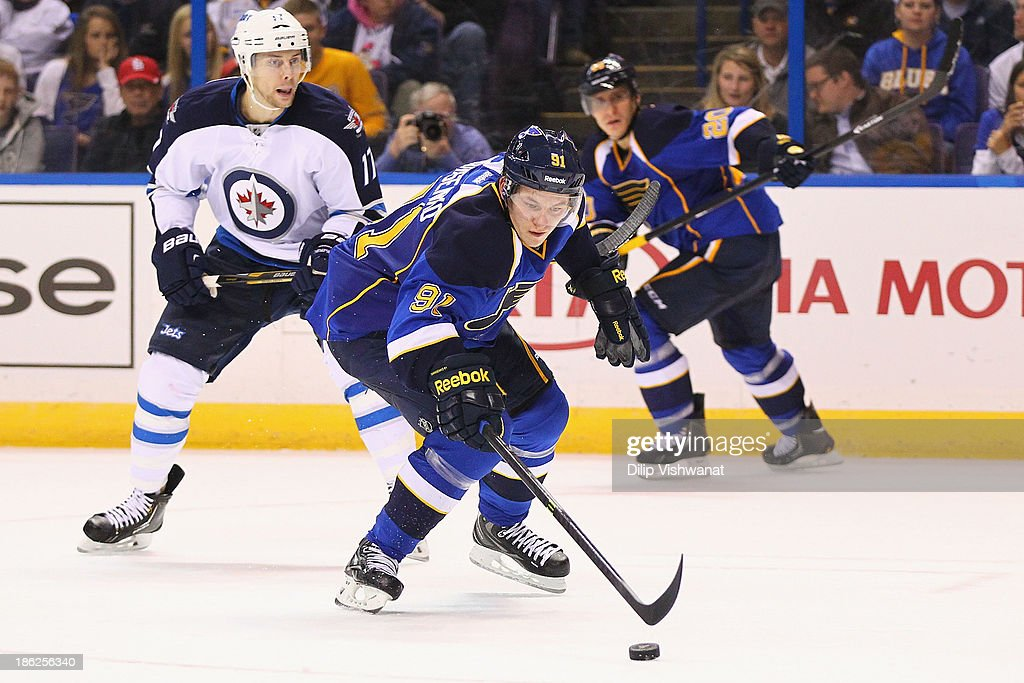 <a gi-track='captionPersonalityLinkClicked' href=/galleries/search?phrase=Vladimir+Tarasenko&family=editorial&specificpeople=6142635 ng-click='$event.stopPropagation()'>Vladimir Tarasenko</a> #91 of the St. Louis Blues regains control of the puck against James Wright #17 of the Winnipeg Jets at the Scottrade Center on October 29, 2013 in St. Louis, Missouri. The Blues beat the Jets 3-2.