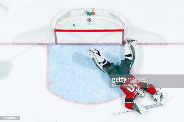 Vladimir Tarasenko of the St Louis Blues scores a goal against a diving Devan Dubnyk of the Minnesota Wild during the game on March 7 2017 at the...