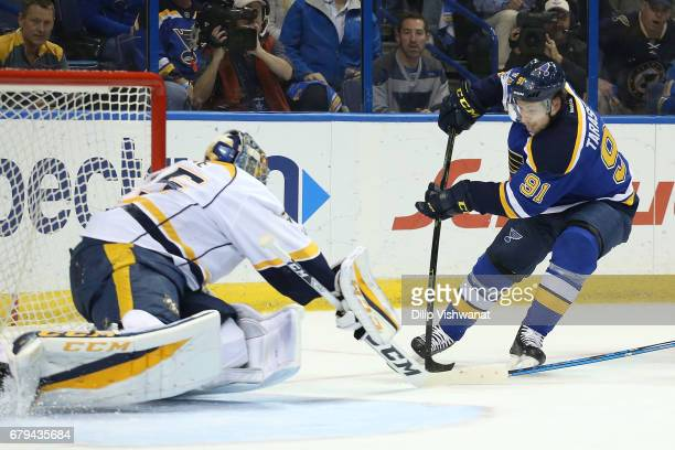 Vladimir Tarasenko of the St Louis Blues shoots the puck against the Pekka Rinne of the Nashville Predators in Game Five of the Western Conference...