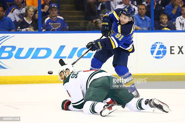 Vladimir Tarasenko of the St Louis Blues shoots the puck over Charlie Coyle of the Minnesota Wild during Game One of the Western Conference...