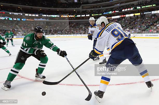 Vladimir Tarasenko of the St Louis Blues skates the puck against Tyler Seguin of the Dallas Stars during a preseason game at American Airlines Center...