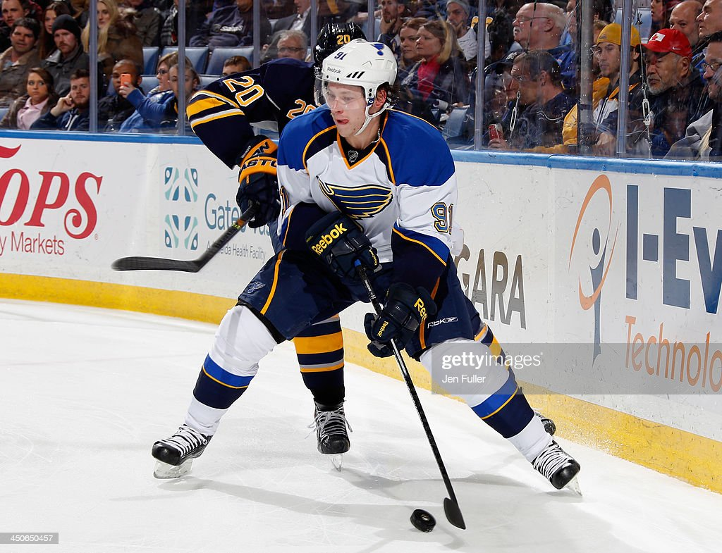 <a gi-track='captionPersonalityLinkClicked' href=/galleries/search?phrase=Vladimir+Tarasenko&family=editorial&specificpeople=6142635 ng-click='$event.stopPropagation()'>Vladimir Tarasenko</a> #91 of the St. Louis Blues skates with the puck along the boards against <a gi-track='captionPersonalityLinkClicked' href=/galleries/search?phrase=Henrik+Tallinder&family=editorial&specificpeople=204661 ng-click='$event.stopPropagation()'>Henrik Tallinder</a> #20 of the Buffalo Sabres at First Niagara Center on November 19, 2013 in Buffalo, New York.