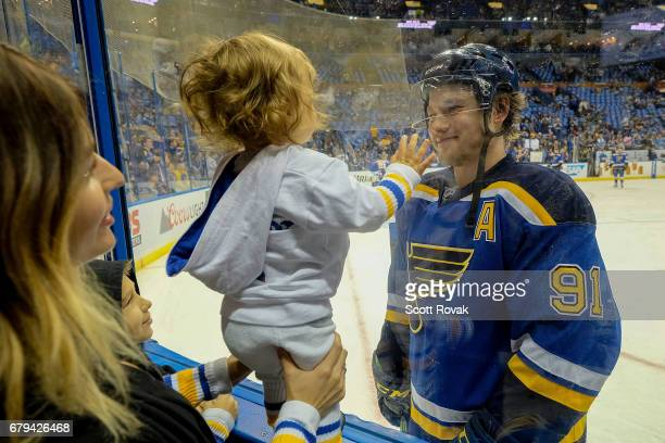 Vladimir Tarasenko of the St Louis Blues smiles with son Aleksandr and wife Yana during warmups before Game Five of the Western Conference Second...