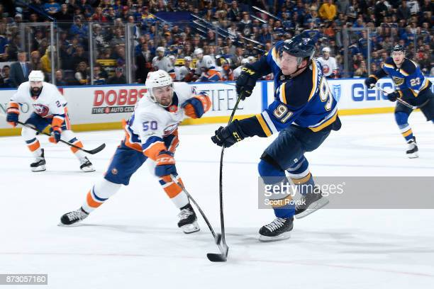 Vladimir Tarasenko of the St Louis Blues takes a shot as Adam Pelech of the New York Islanders defends at Scottrade Center on November 11 2017 in St...