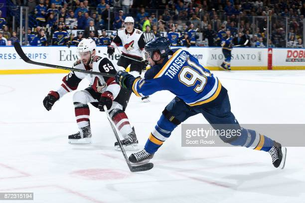 Vladimir Tarasenko of the St Louis Blues takes a shot as Jason Demers of the Arizona Coyotes at Scottrade Center on November 9 2017 in St Louis...