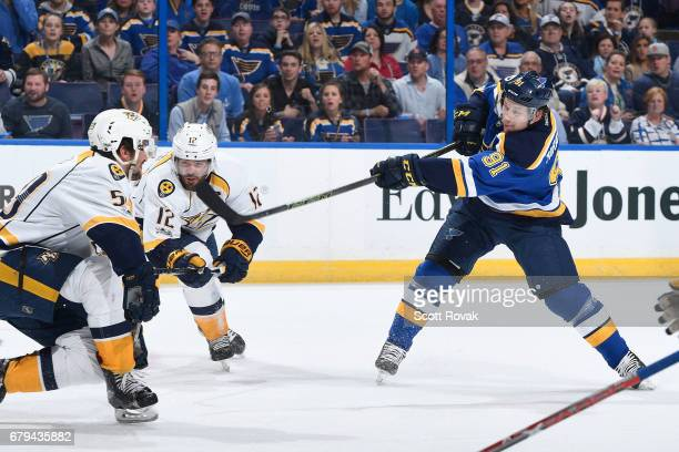 Vladimir Tarasenko of the St Louis Blues takes a shot as Roman Josi of the Nashville Predators and Mike Fisher of the Nashville Predators defend in...