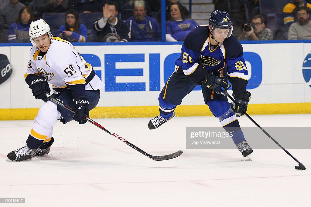 <a gi-track='captionPersonalityLinkClicked' href=/galleries/search?phrase=Vladimir+Tarasenko&family=editorial&specificpeople=6142635 ng-click='$event.stopPropagation()'>Vladimir Tarasenko</a> #91 of the St. Louis Blues takes a shot on goal against <a gi-track='captionPersonalityLinkClicked' href=/galleries/search?phrase=Roman+Josi&family=editorial&specificpeople=4247871 ng-click='$event.stopPropagation()'>Roman Josi</a> #59 of the Nashville Predators at the Scottrade Center on February 5, 2013 in St. Louis, Missouri.