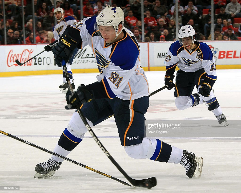 <a gi-track='captionPersonalityLinkClicked' href=/galleries/search?phrase=Vladimir+Tarasenko&family=editorial&specificpeople=6142635 ng-click='$event.stopPropagation()'>Vladimir Tarasenko</a> #91 of the St Louis Blues takes a slap shot during a NHL game against the Detroit Red Wings at Joe Louis Arena on February 1, 2013 in Detroit, Michigan.