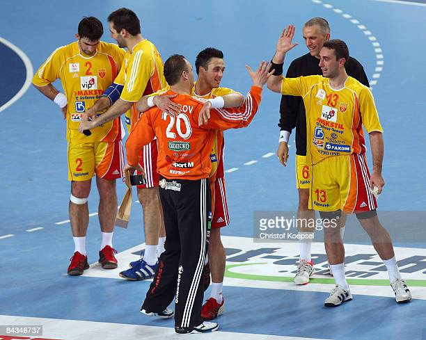 Vladimir Temelkov of Macedonia embraces Petar Angelov of Macedonia after winning 3219 the Men's World Handball Championships match between Algeria...