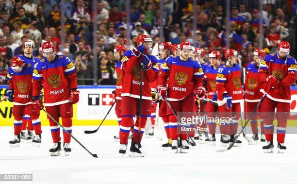 Vladimir Tkachyov of Russia and team mates are dejected after losing the Russia v USA 2017 IIHF Ice Hockey World Championship match at Lanxess Arena...