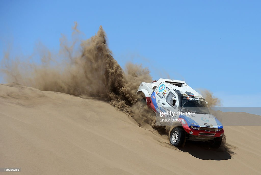 Vladimir Vasilyev and co-driver Vitaliy Yevtyekhov of team G-Force Proto compete in stage 6 from Arica to Calama during the 2013 Dakar Rally on January 10, 2013 in Arica, Chile.