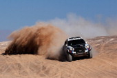 Vladimir Vasilyev and Vitaliy Yevtyekhov of Russia for MINI XRaid Team compete in stage 11 on the way to El Salvador during Day 12 of the 2014 Dakar...