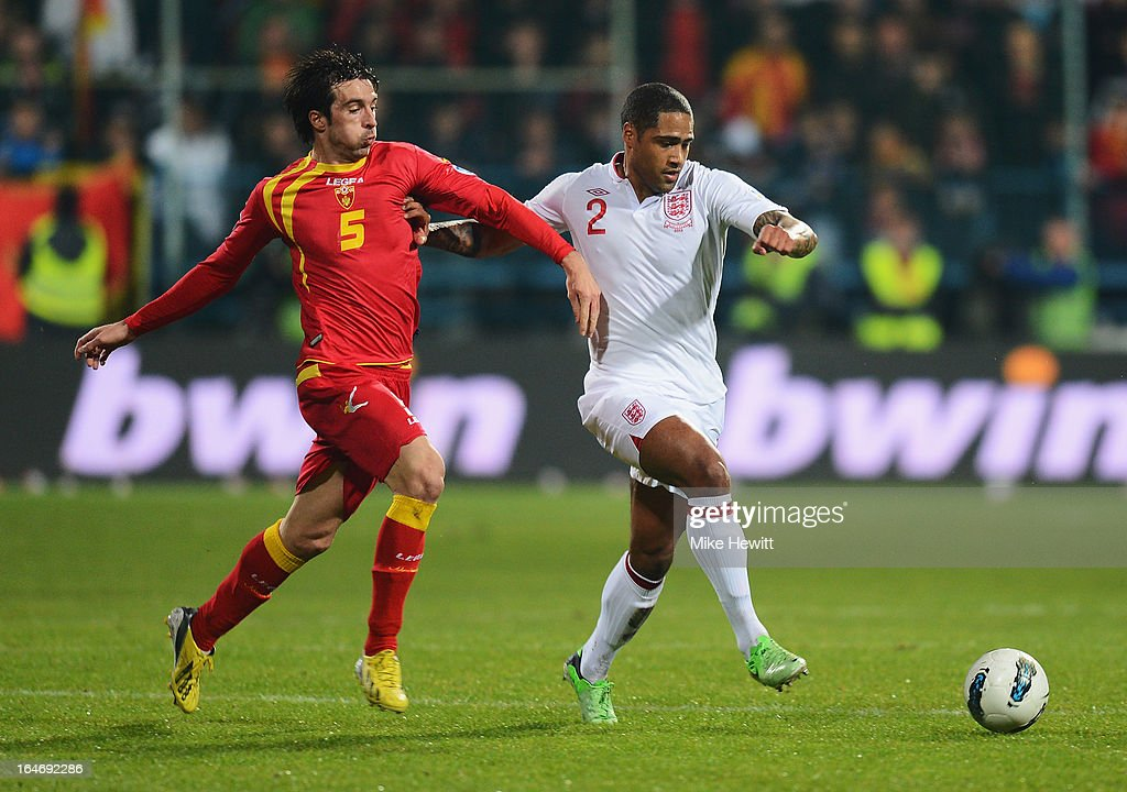 Vladimir Volkov of Montenegro and <a gi-track='captionPersonalityLinkClicked' href=/galleries/search?phrase=Glen+Johnson&family=editorial&specificpeople=209192 ng-click='$event.stopPropagation()'>Glen Johnson</a> (R) of England compete for the ball during the FIFA 2014 World Cup Group H Qualifier between Montenegro and England at City Stadium on March 26, 2013 in Podgorica, Montenegro.