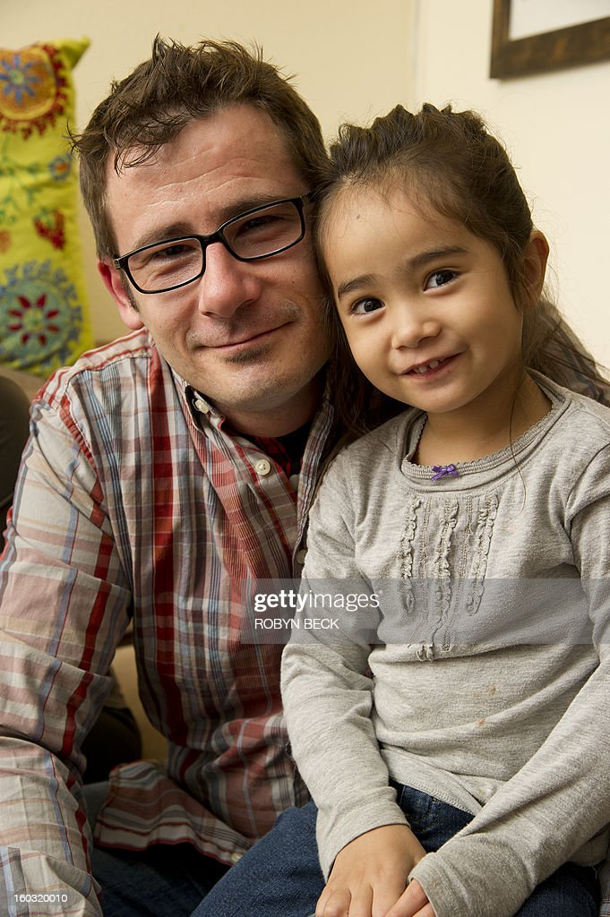 Vladimir Vrnoga poses with his daughter Vanessa at his home in Chico, California on December 16, 2012. Twenty years have passed since Vrnoga served three hard years in the Bosnian and fled to the United States. He now lives with his mother, his wife and three year old daughter in Chico, north of San Francisco, where he is employed by a large beverage manufacturer.