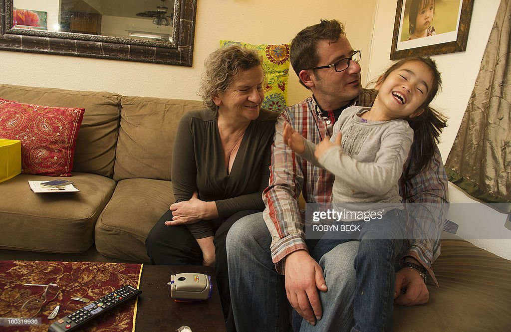Vladimir Vrnoga (C) poses with his mother Milena and daughter Vanessa at his home in Chico, California on December 16, 2012. Twenty years have passed since Vrnoga served three hard years in the Bosnian and fled to the United States. He now lives with his mother, his wife and three year old daughter in Chico, north of San Francisco, where he is employed by a large beverage manufacturer.