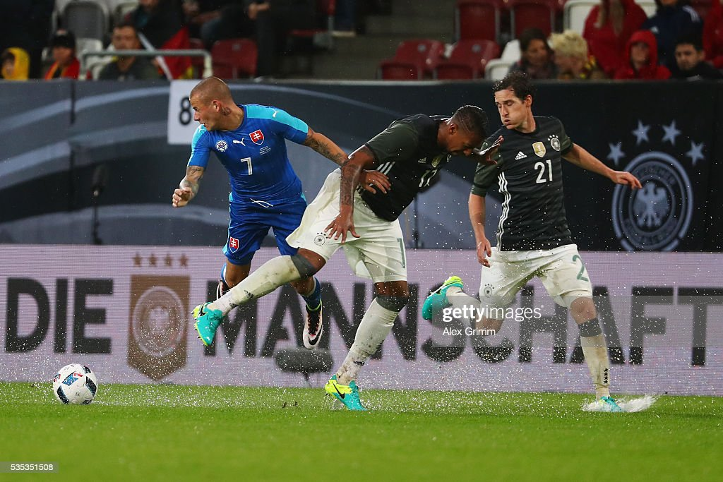 Vladimir Weiss of Slovakia is challenged by <a gi-track='captionPersonalityLinkClicked' href=/galleries/search?phrase=Jerome+Boateng&family=editorial&specificpeople=2192287 ng-click='$event.stopPropagation()'>Jerome Boateng</a> and <a gi-track='captionPersonalityLinkClicked' href=/galleries/search?phrase=Sebastian+Rudy&family=editorial&specificpeople=4410074 ng-click='$event.stopPropagation()'>Sebastian Rudy</a> (L-R) of Germany during the international friendly match between Germany and Slovakia at WWK-Arena on May 29, 2016 in Augsburg, Germany.