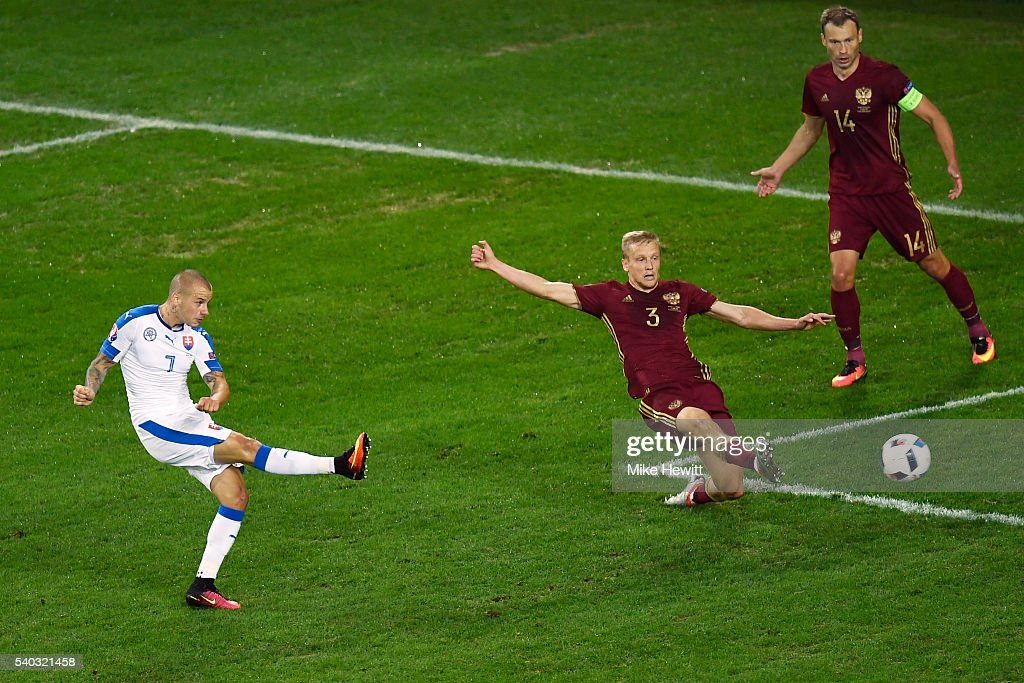 Vladimir Weiss of Slovakia scores the opening goal during the UEFA EURO 2016 Group B match between Russia and Slovakia at Stade PierreMauroy on June...